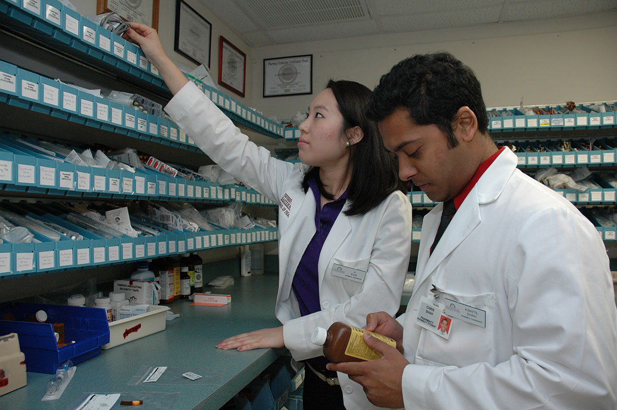 busy male and female pharmacy student